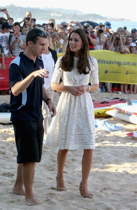 Kate Middleton's Shoes Stay On As She Frolicks On The Beach